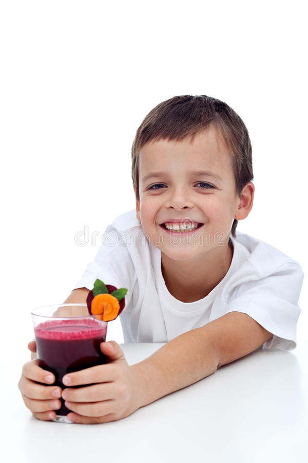 Happy healthy kid with fresh fruit juice stock images
