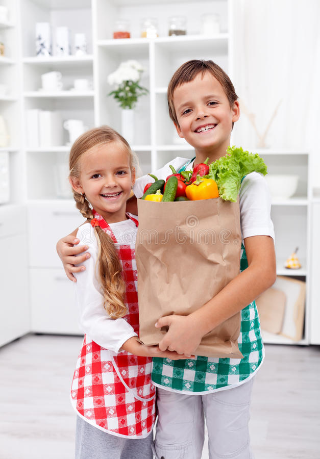 Happy healthy kids with the grocery bag stock photo