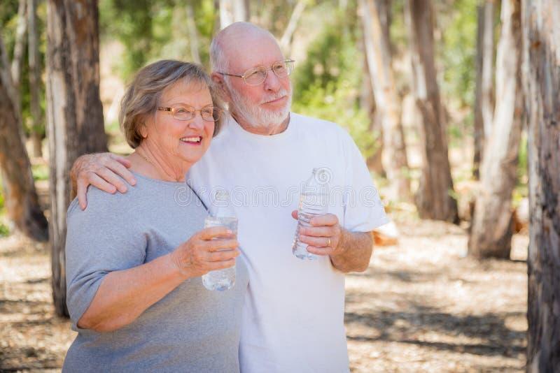 Happy Healthy Senior Couple Drinking Water Bottles Outdoors. Happy Healthy Senior Couple with Water Bottles Outdoors royalty free stock photos