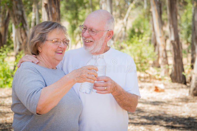 Happy Healthy Senior Couple with Water Bottles. Outdoors royalty free stock photography