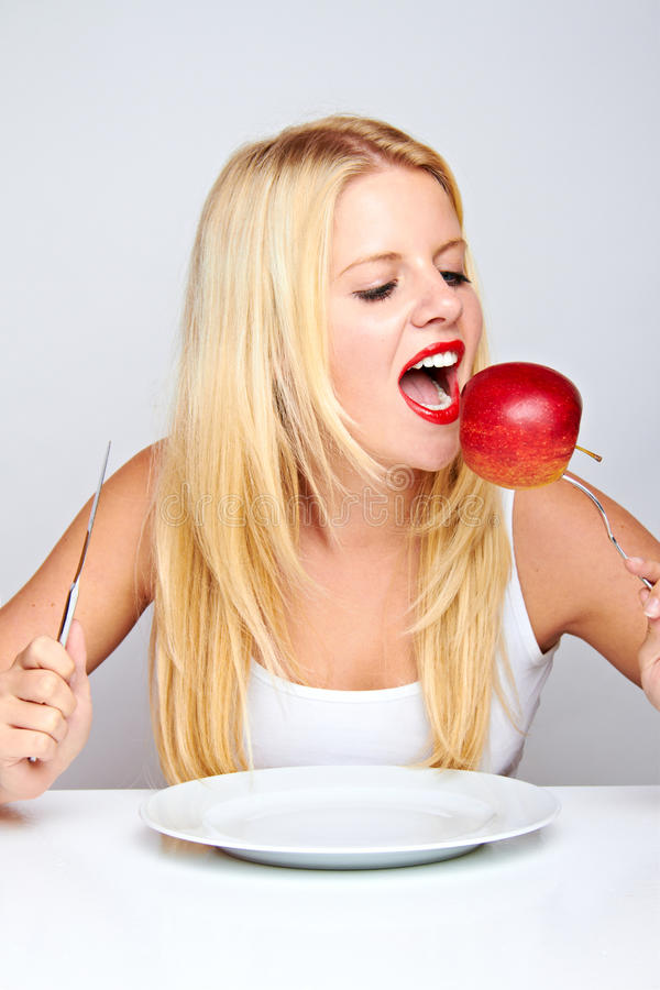 Happy healthy woman with apple stock image