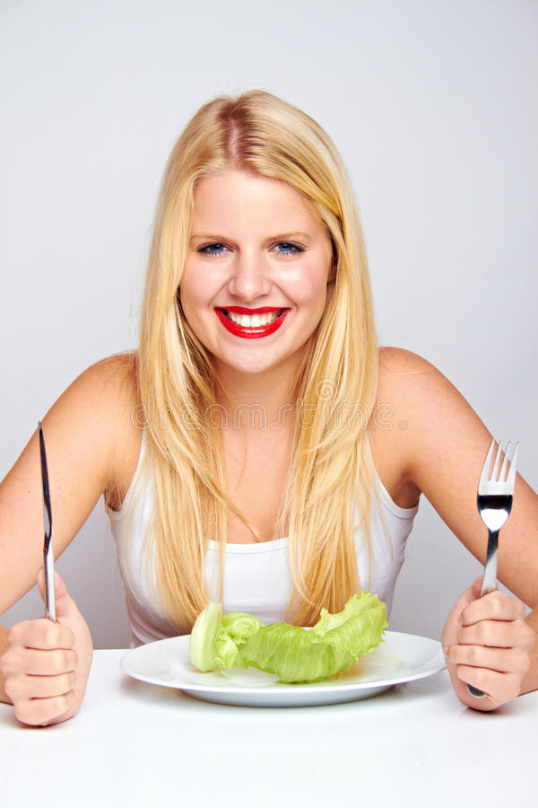 Happy healthy woman with lettuce stock photos