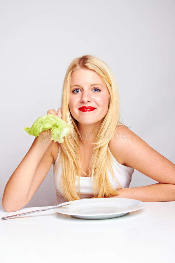 Happy healthy woman with lettuce stock photography