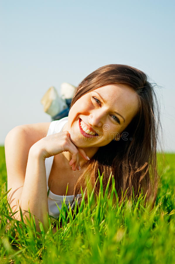 Happy Healthy Woman Lying In The Grass Stock Image