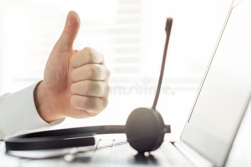 Happy help desk or call center person showing thumbs up. royalty free stock image