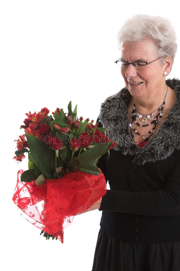 Happy with her flowers royalty free stock image
