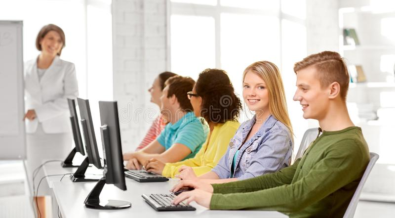 Happy high school students in computer class royalty free stock photos