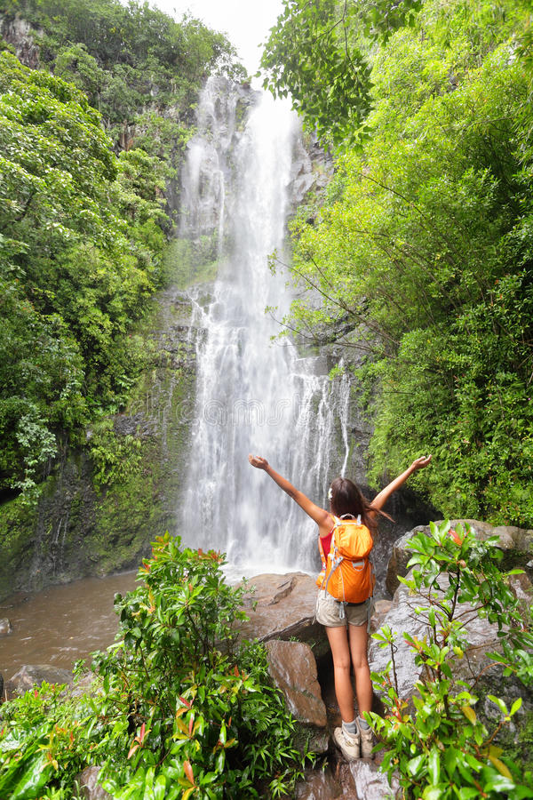 Happy hiker - Hawaii tourists hiking by waterfall stock image