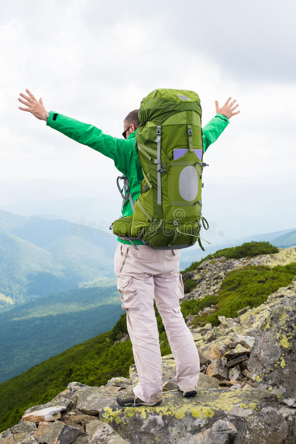 Happy hiker in mountains royalty free stock images