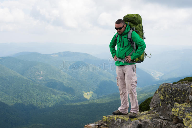 Happy hiker in mountains royalty free stock image