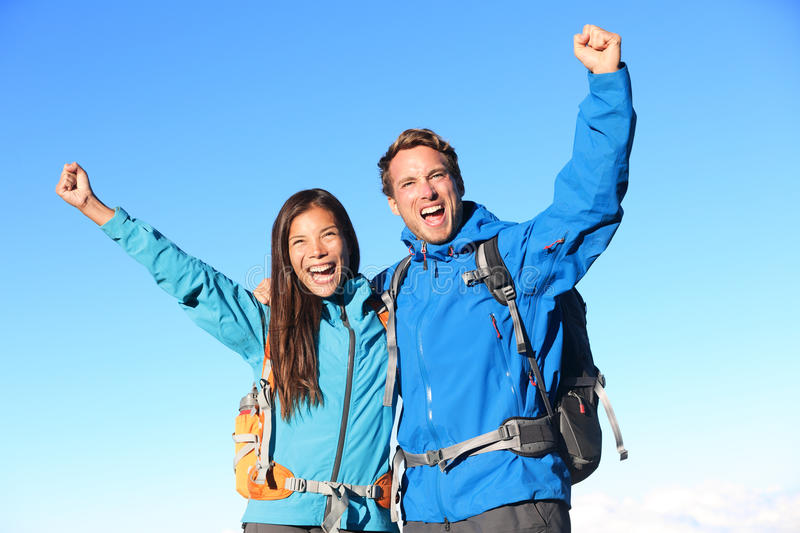 Happy hiking couple cheering royalty free stock images