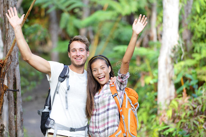 Happy hiking - hikers cheering joyful in forest royalty free stock photography