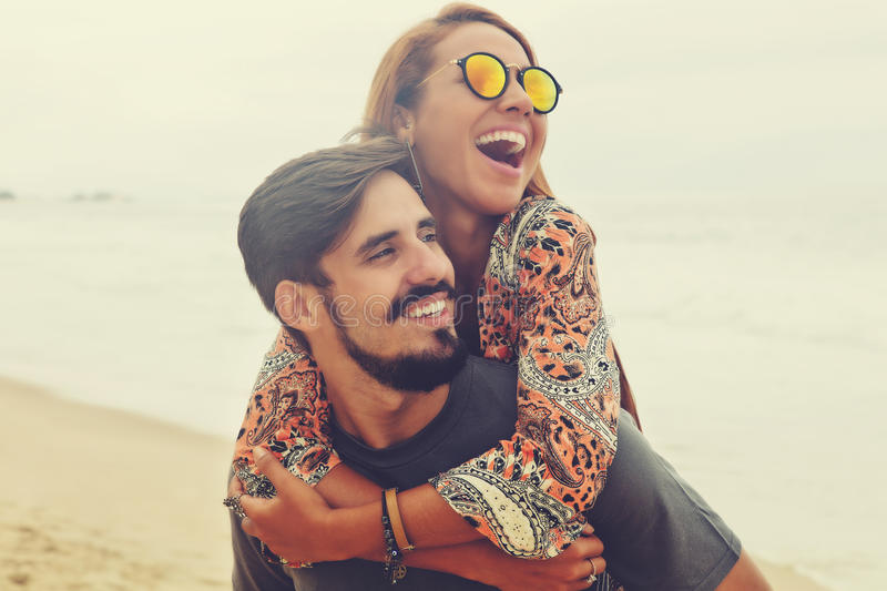 Happy hippie love couple in vintage summer style stock images