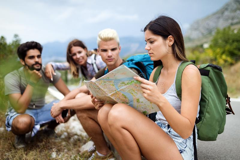 Happy hipster company of friends traveling around world stock photo