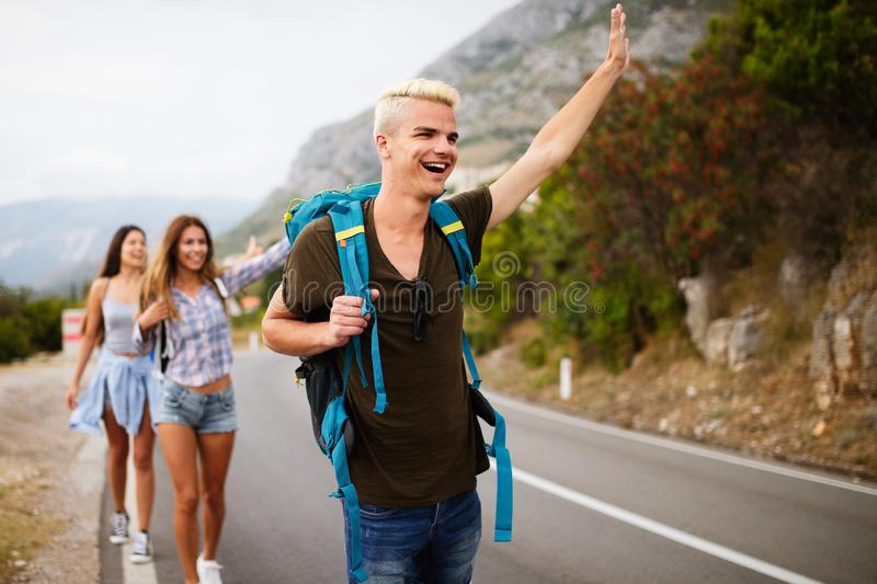 Happy hipster company of friends traveling around world royalty free stock image
