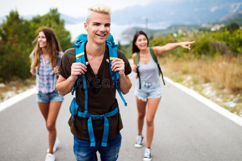 Happy hipster company of friends traveling around world stock photography