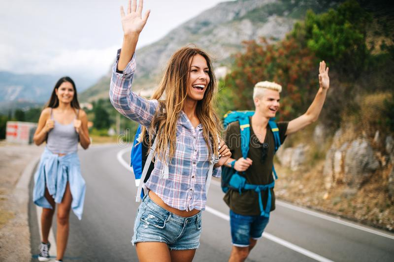 Happy hipster company of friends traveling around world royalty free stock photo