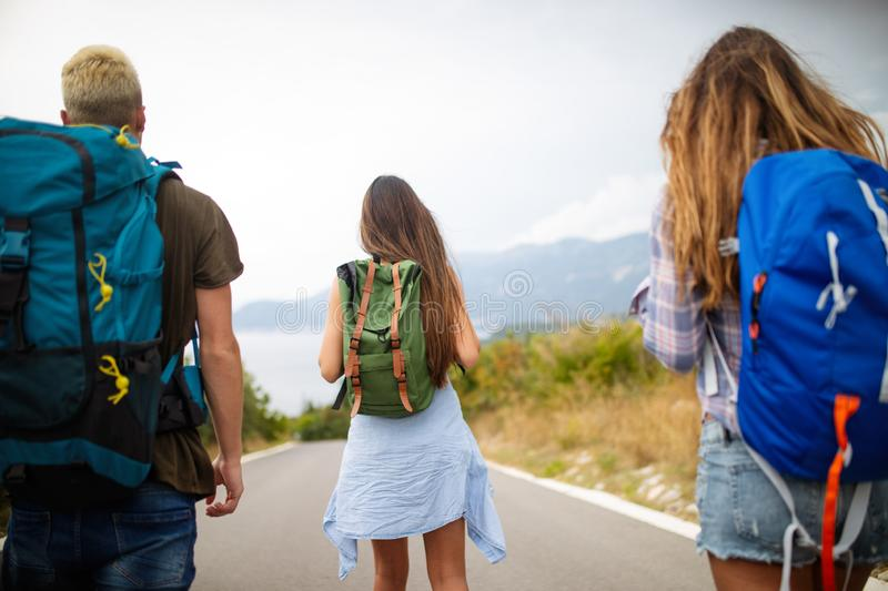 Happy hipster company of friends traveling around world royalty free stock photography