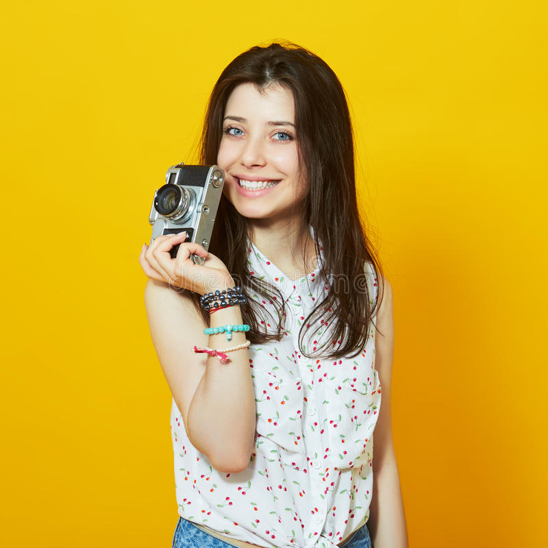 Happy hipster girl with retro camera stock images