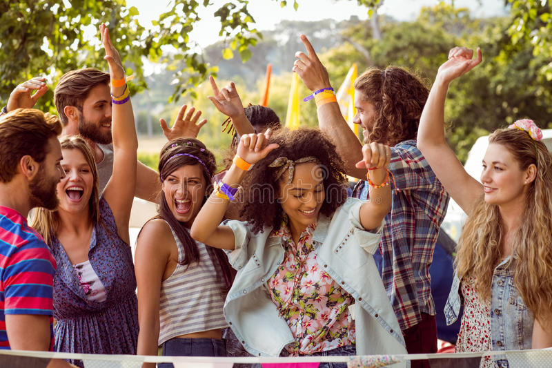 Happy hipsters dancing to the music stock image
