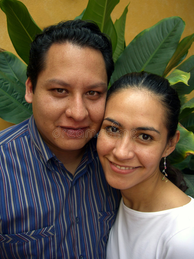 Happy Hispanic Couple-Vertical royalty free stock photography