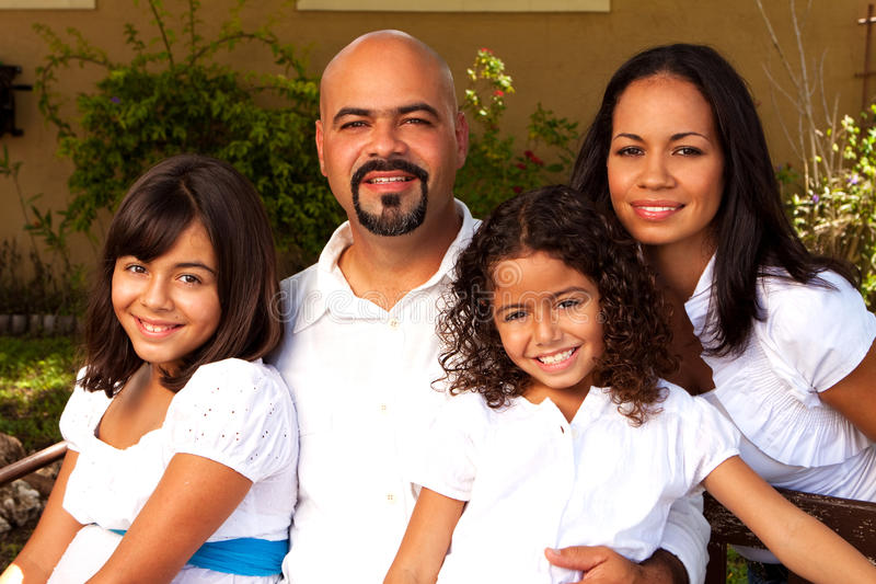 Happy Hispanic family laughing and smiling. stock photo