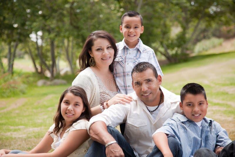Happy Hispanic Family In the Park stock photo