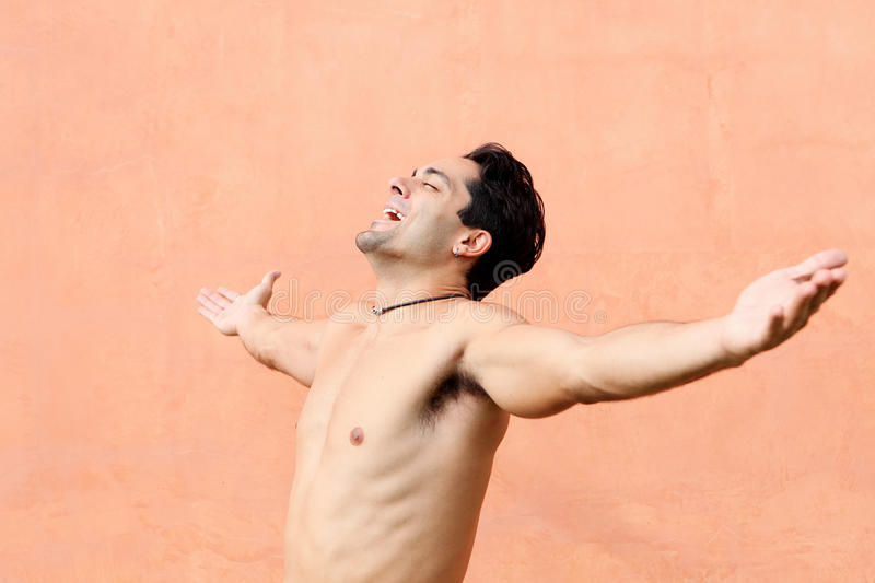 Happy hispanic man. With arms outstretched stock images