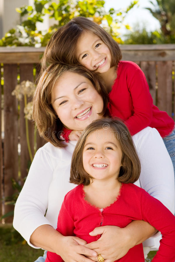 Happy Hispanic mother and her daughter. stock photos