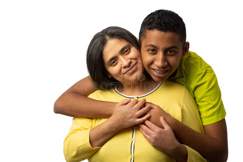 Happy Hispanic Mother with Teenage Son stock images