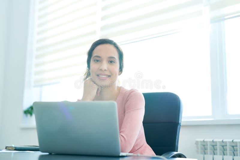 Happy Hispanic office manager stock photos