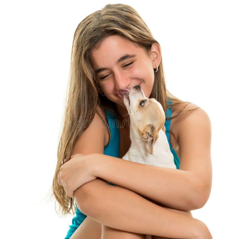 Happy hispanic teenage girl with her small dog. Portrait of a happy hispanic teenage girl with stock image