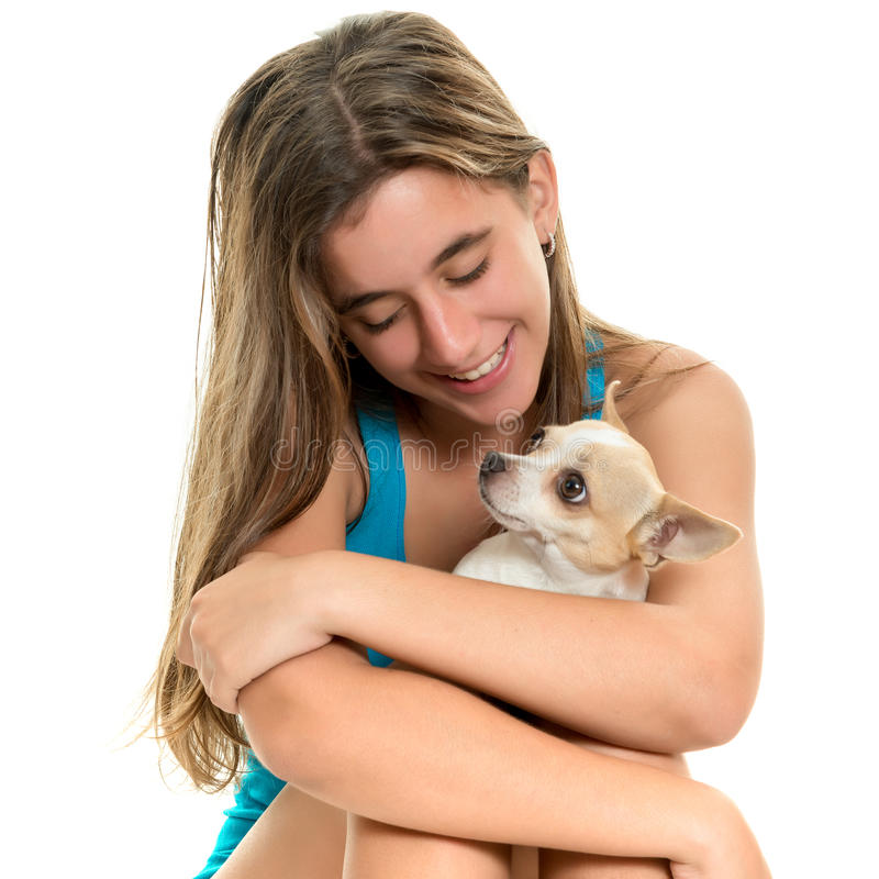 Happy hispanic teenage girl with her small dog. Portrait of a happy hispanic teenage girl with stock photo