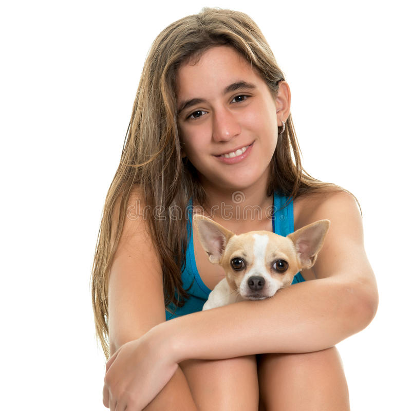 Happy hispanic teenage girl with her small dog. Portrait of a happy hispanic teenage girl with her small chihuahua dog - Isolated on white stock photos