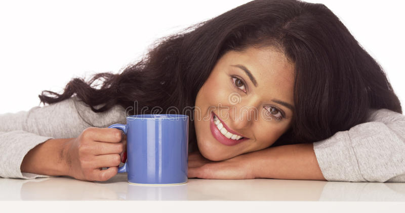 Happy Hispanic woman smiling with coffee stock images