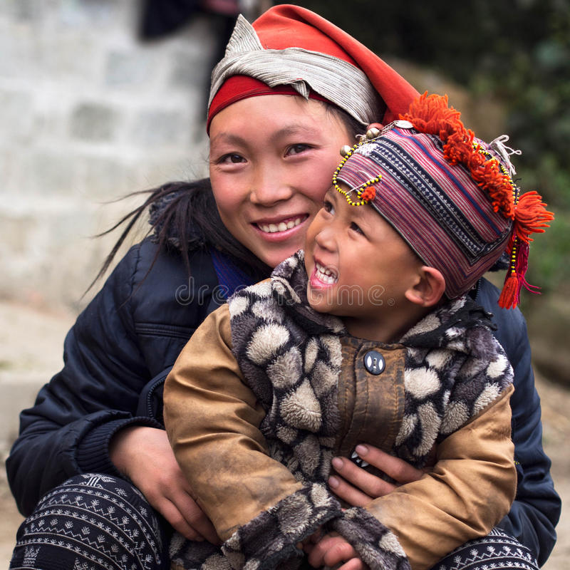 Happy Hmong Woman and Child, Sapa, Vietnam. Happy Hmong women and child smiling, sitting outside their house at Giang Ta Chai village near the hill town of Sa Pa