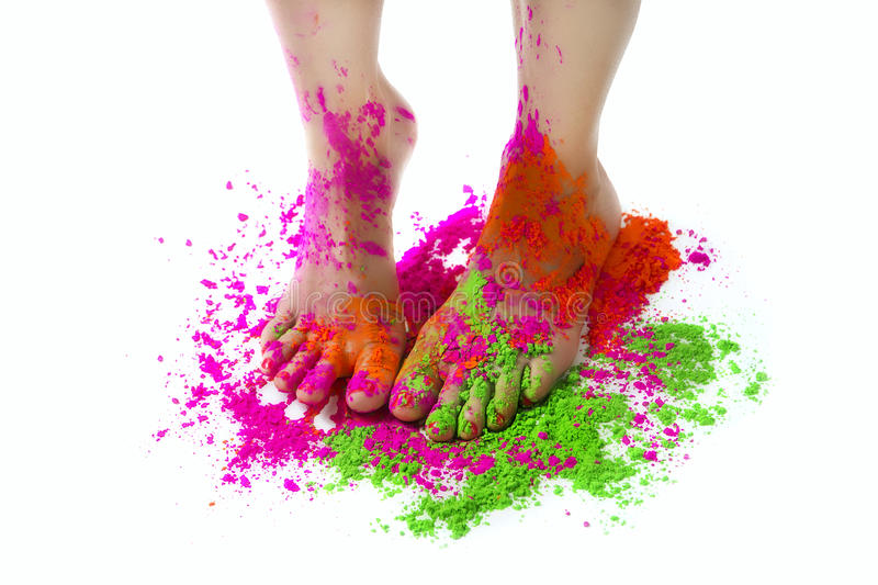 Happy Holi Festival! Holi Celebration Party - female feet colored Multicolor Paint stock image