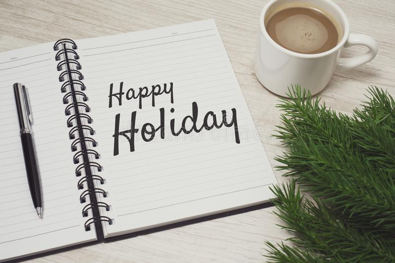 Happy Holiday written on notebook royalty free stock photos
