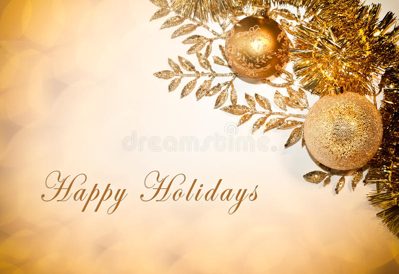 Happy Holidays Card. Decorative card with Happy Holidays text, balls and glitter royalty free stock image