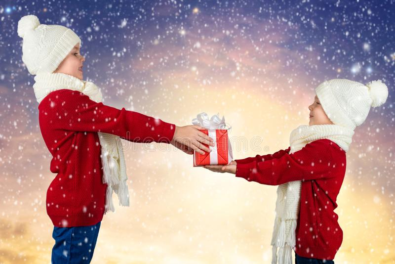 Merry Christmas and Happy Holidays!The elder brother gives younger brother a gift stock photos