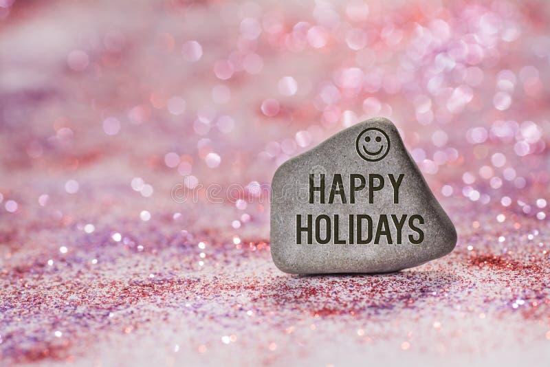 Happy holidays engrave on stone stock photo