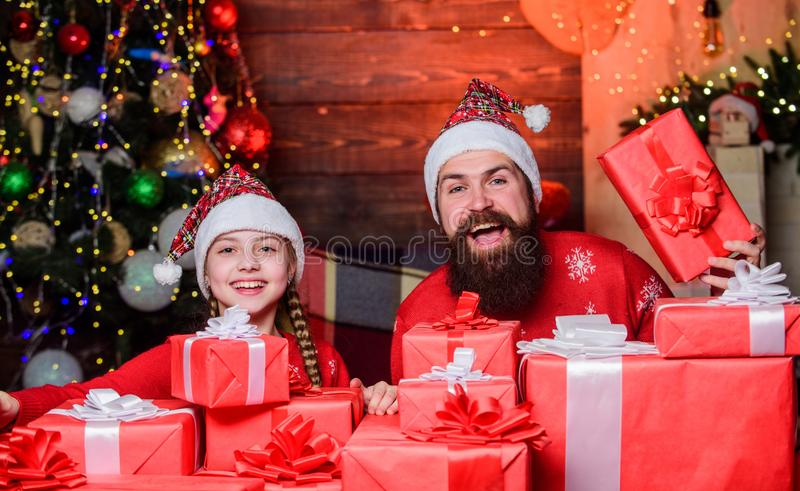 Happy holidays. Favorite childhood memories of christmas. Father bearded man and daughter near christmas tree. Spend stock photography