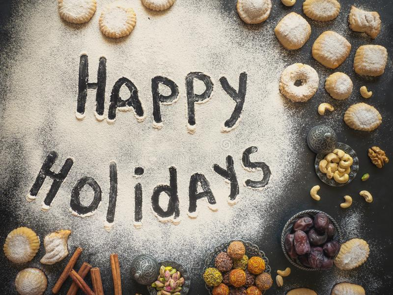 Happy holidays food background. Arab sweets are laid out on a black table. Happy holidays food background. Arab sweets are laid out on a black table royalty free stock image