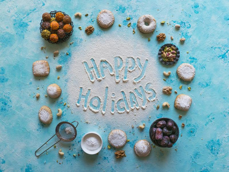 Happy holidays food background. Arab sweets are laid out on a blue table.  royalty free stock image
