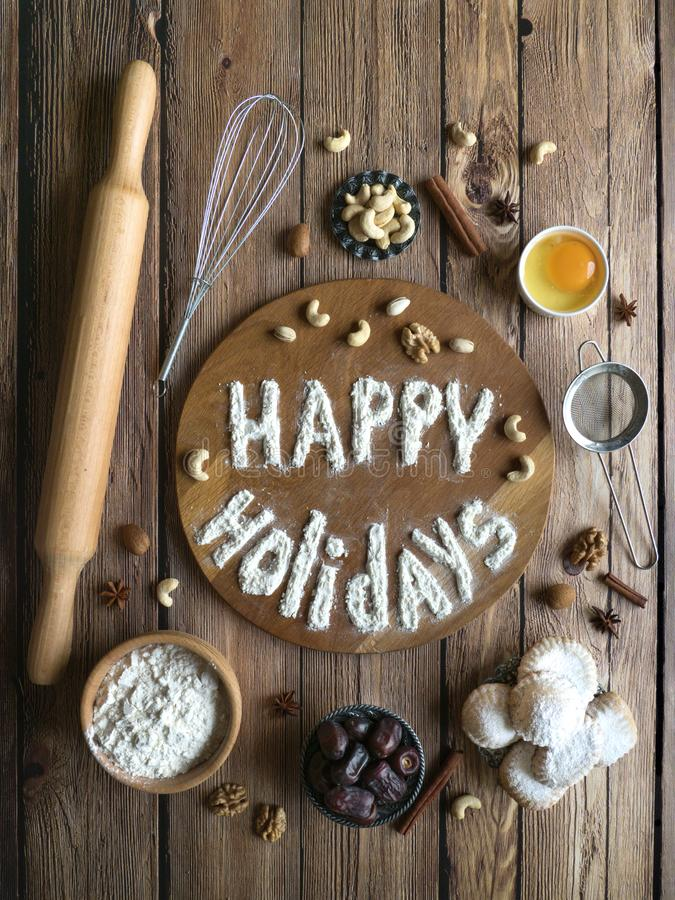 Free Happy Holidays Food Background. Egg, Flour And Nuts Are Laid Out On A Wooden Table. Royalty Free Stock Photo - 150733375