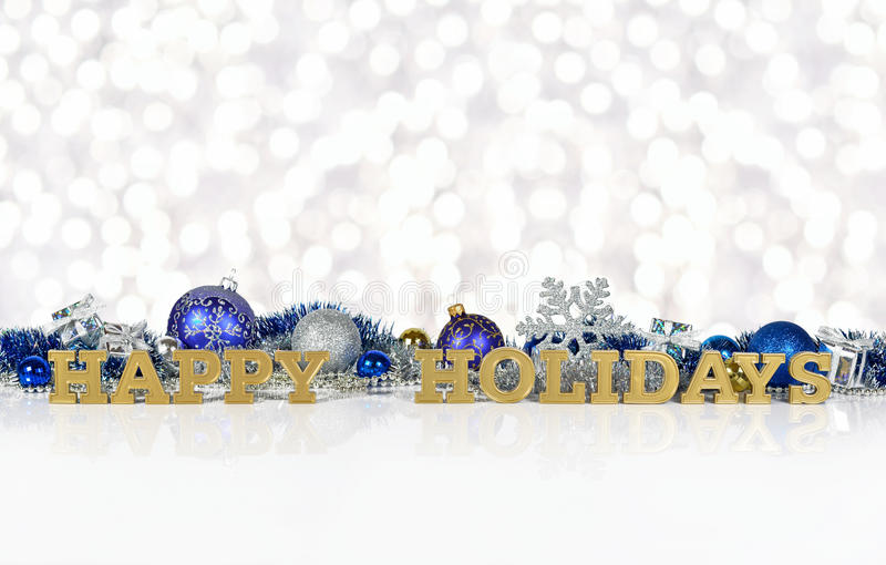 Happy holidays golden text and Christmas decorations royalty free stock image