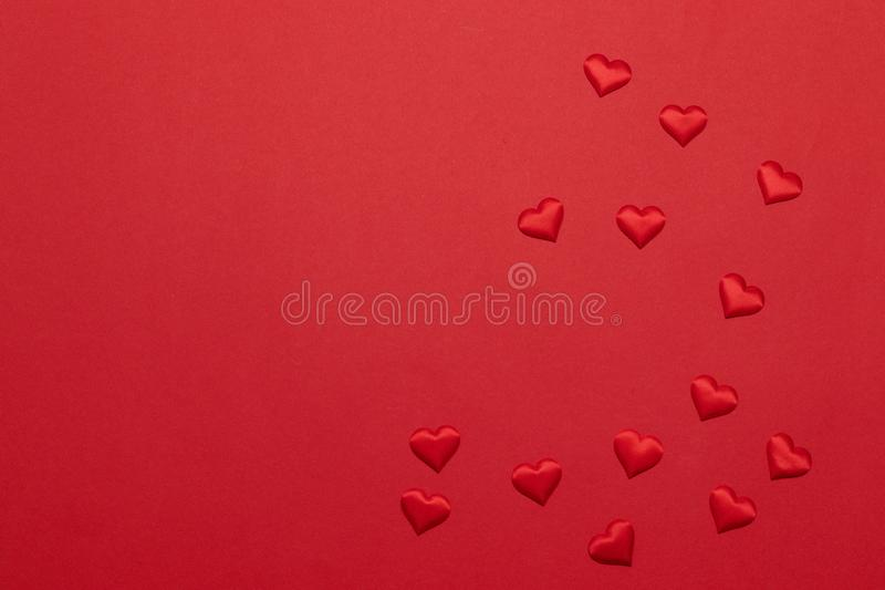 Happy holidays greeting card with heart shape on a red background. Birthday, Valentine`s Day, Christmas, New Year. Flat Layout royalty free stock image