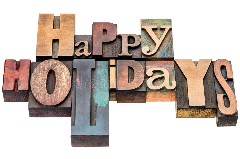 Happy Holidays greetings in wood type stock image