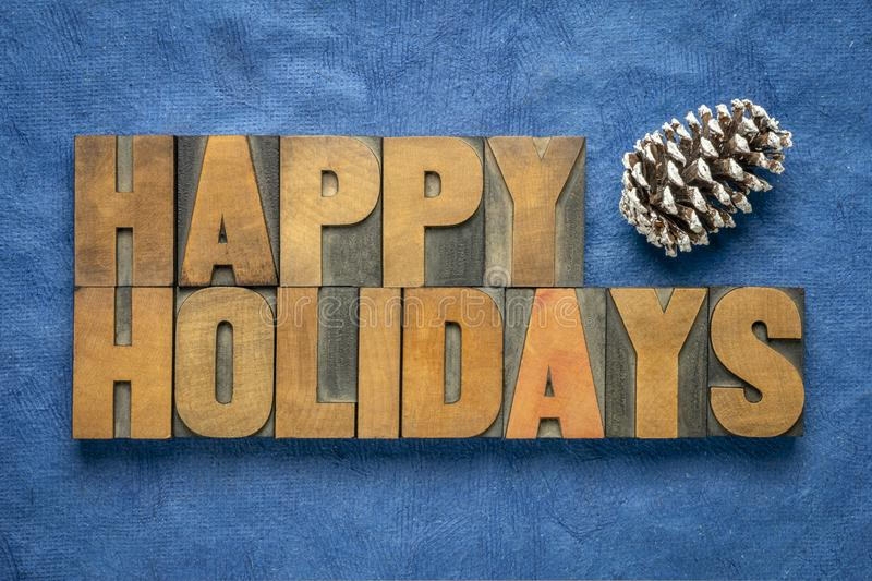 Happy Holidays greetings in wood type stock photography
