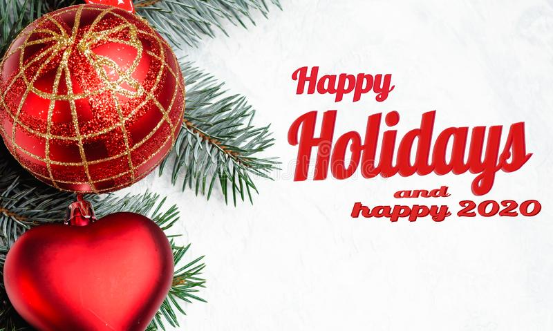 Happy holidays lettering in frame with christmas decorations in red royalty free stock image